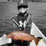 Young Angler with Cutthroat Trout