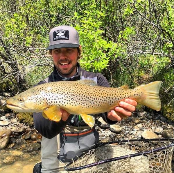 Tanner Lewis fishing guide with brown trout