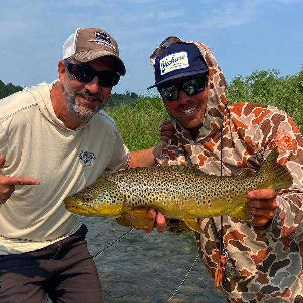 fishing guide tanner lewis with angler and brown trout